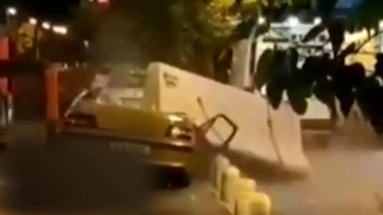 پشت پرده فیلم  له شدن ماشین مرد تهرانی زیر نیوجرسی بتونی / با دیدن این فیلم شوکه می شوید